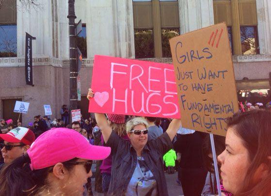 WOMEN MARCH FREE HUGS